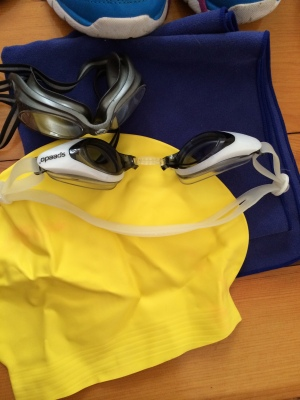 swim cap and goggles